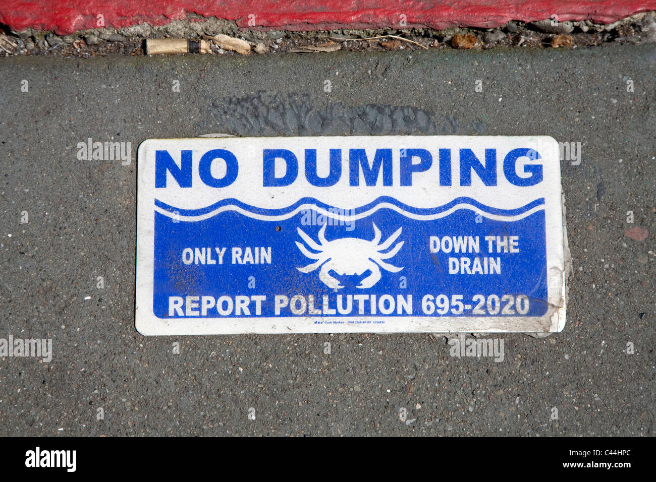 No dumping sign by drain close to bay in San Francisco - Stock Image