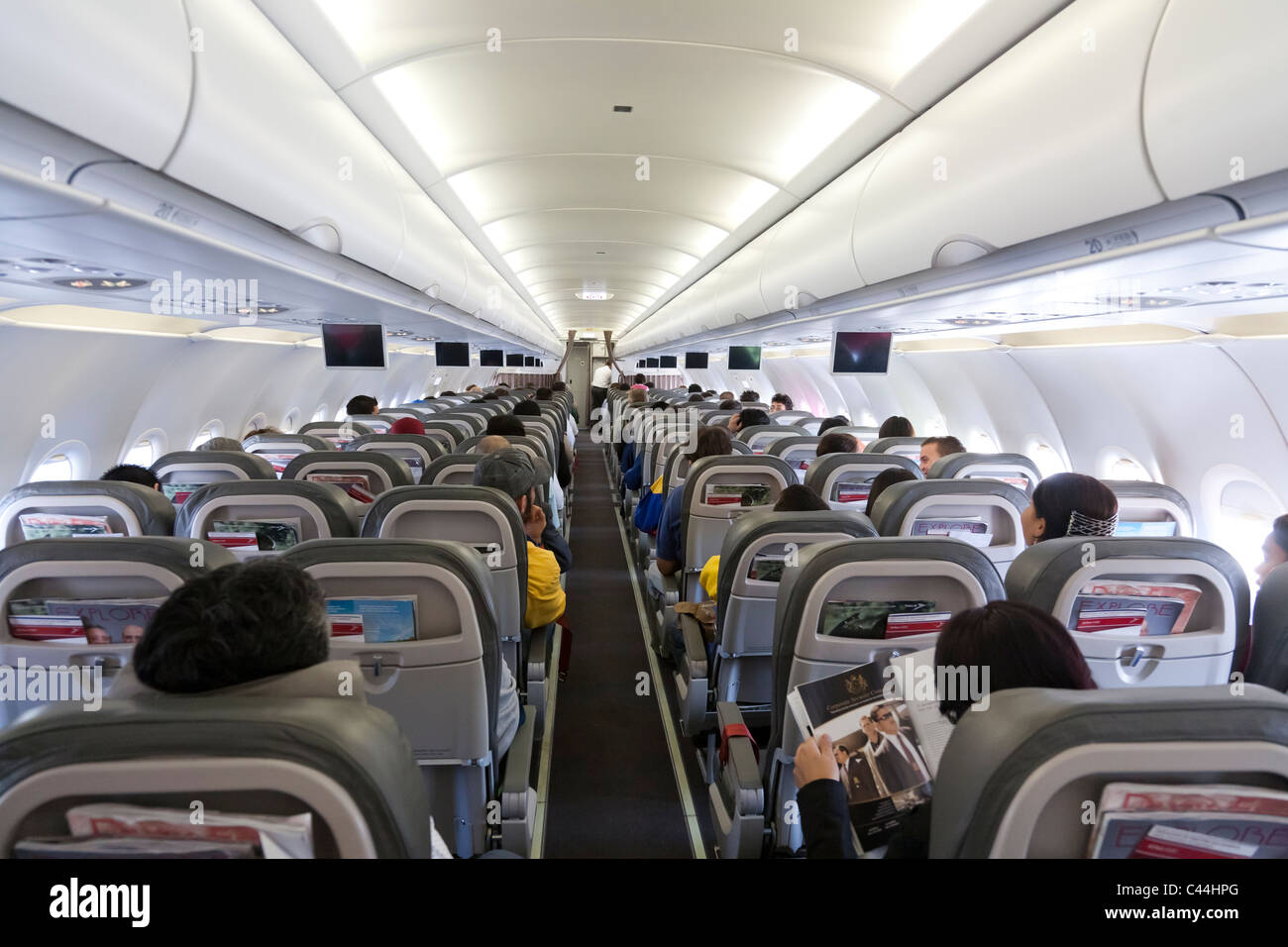 Safety Instructions on monitors before take off inside an airplane. TACA Airline - Stock Image