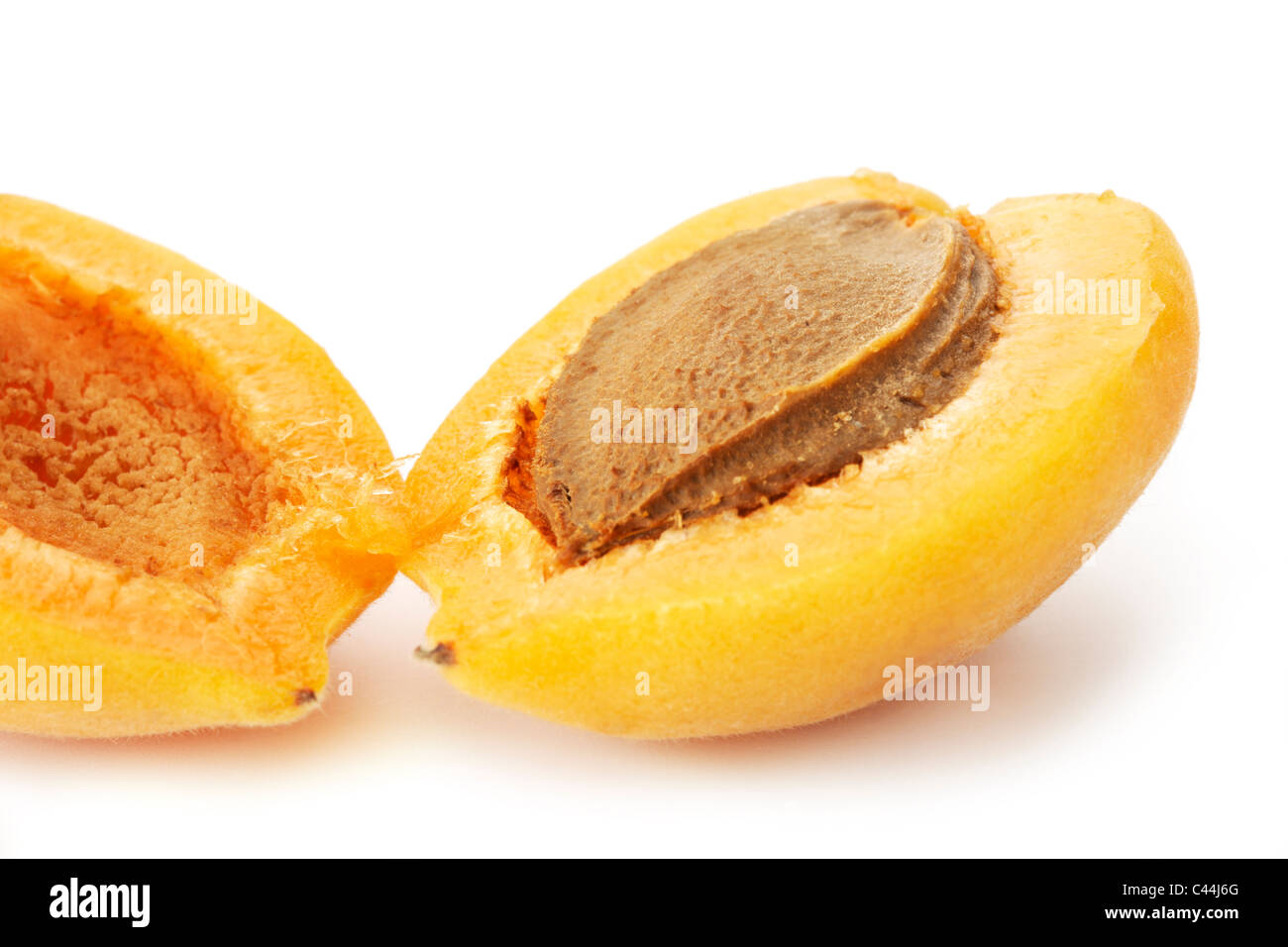 Halved Apricot. Professionally retouched high quality image. - Stock Image