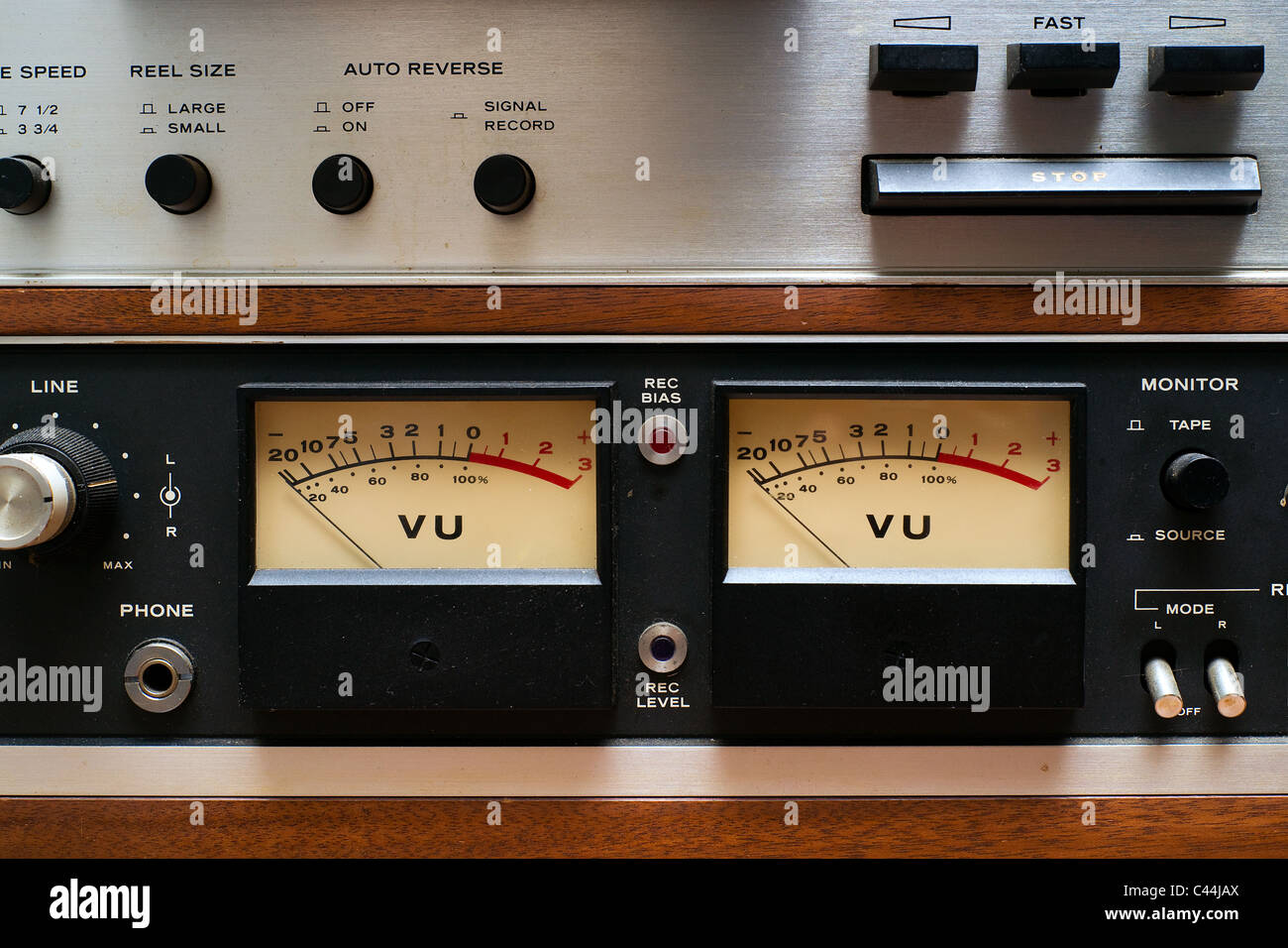 Stereo VU meters on a portion of an old, dirty, vintage, analog reel-to-reel tape deck. - Stock Image