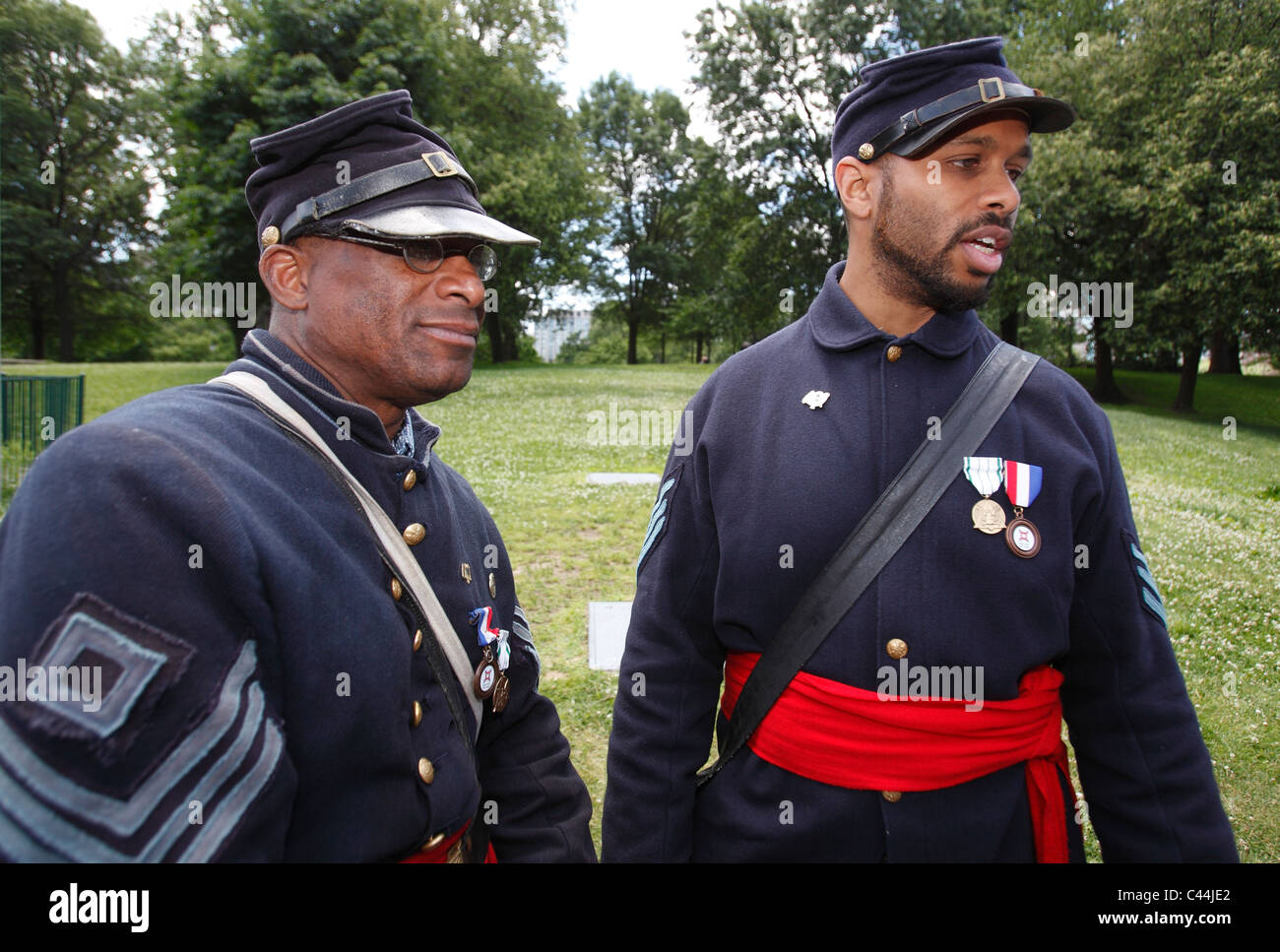 Reenactors in the uniform of the 54th Massachusetts Volunteer Infantry Regiment, an all black unit in the American - Stock Image