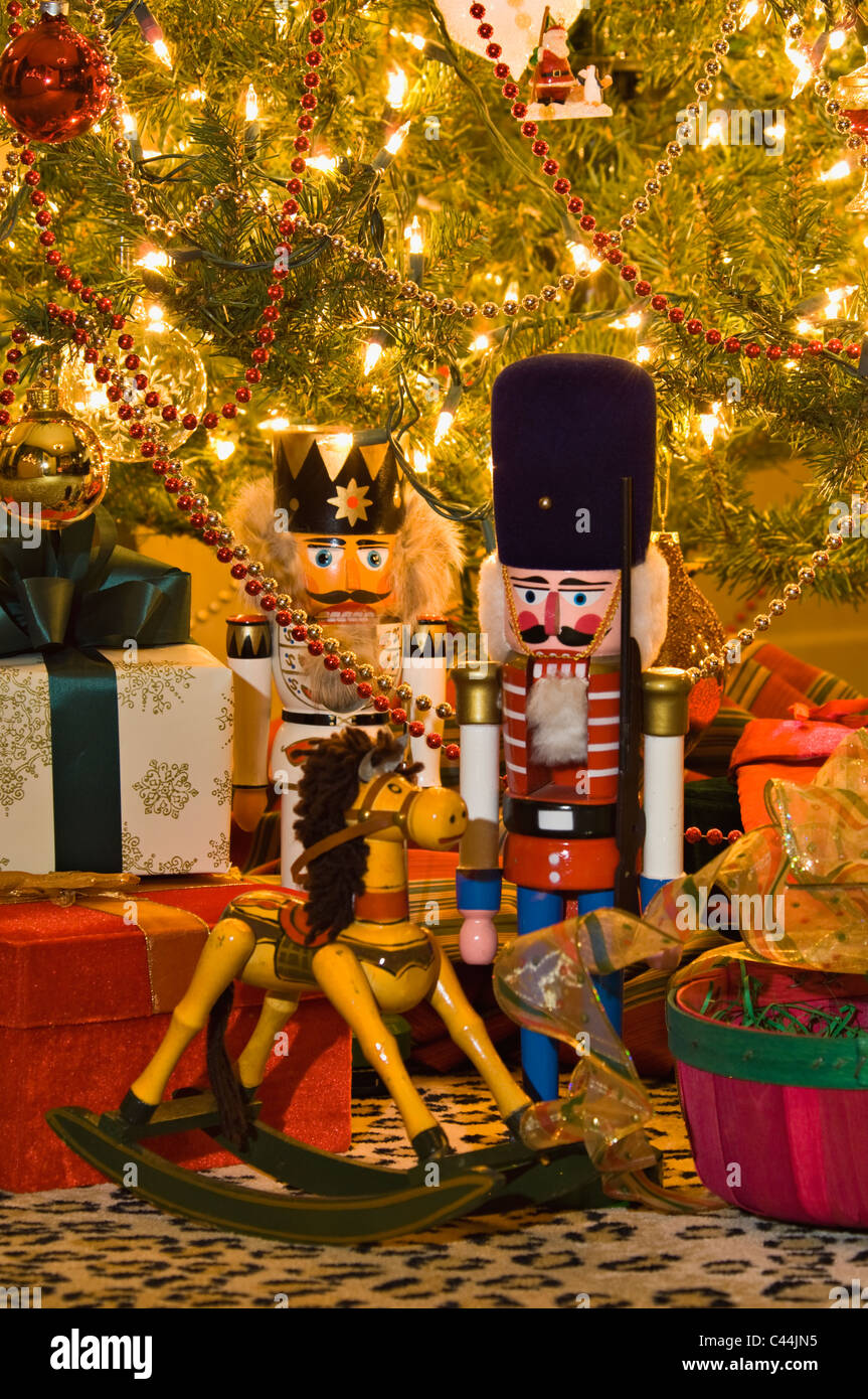 Nutcrackers, Hobby Horse and Gifts under Victorian Christmas Tree in New Albany, Indiana - Stock Image