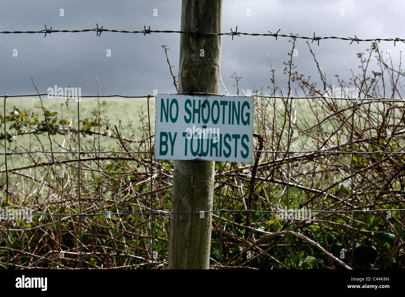 No shooting by tourists sign on wire fence, County Sligo, Republic of Ireland - Stock Image