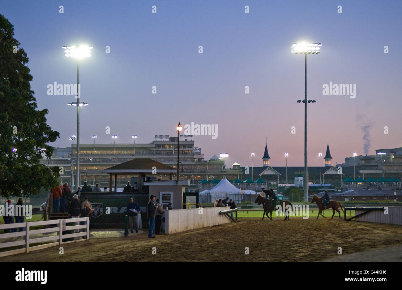 Thoroughbred Horses Getting a Morning Workout seen from the Backside of Churchill Downs at Sunrise in Louisville, - Stock Image