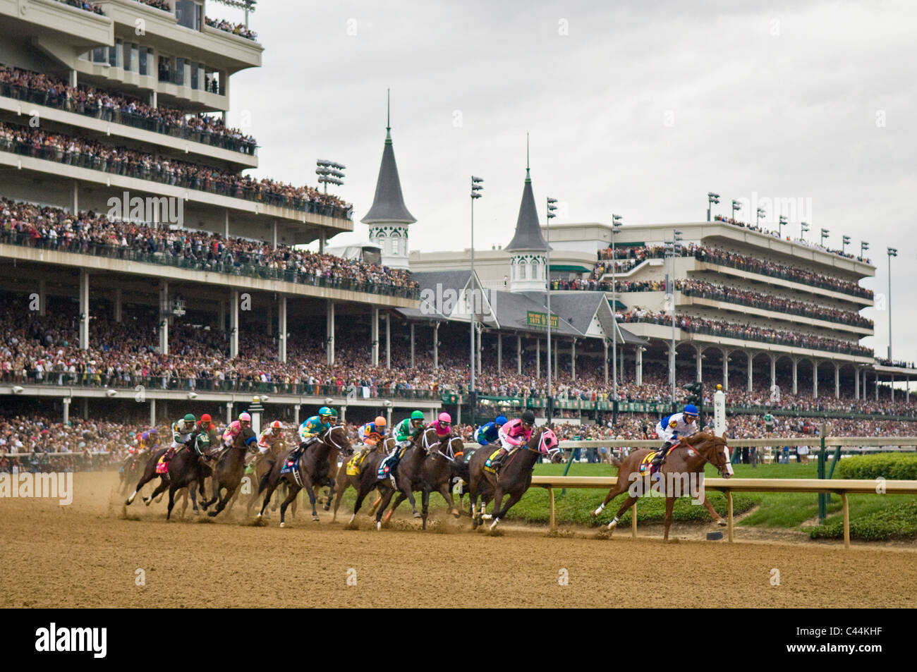 Horses Rounding the First Turn in the 2011 Kentucky Derby at Churchill Downs in Louisville, Kentucky - Stock Image