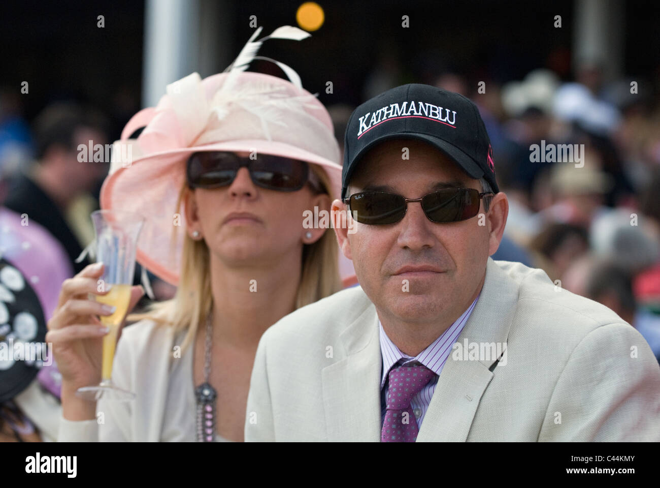 Man and Woman at Churchill Downs on Oaks Day in Louisville, Kentucky - Stock Image