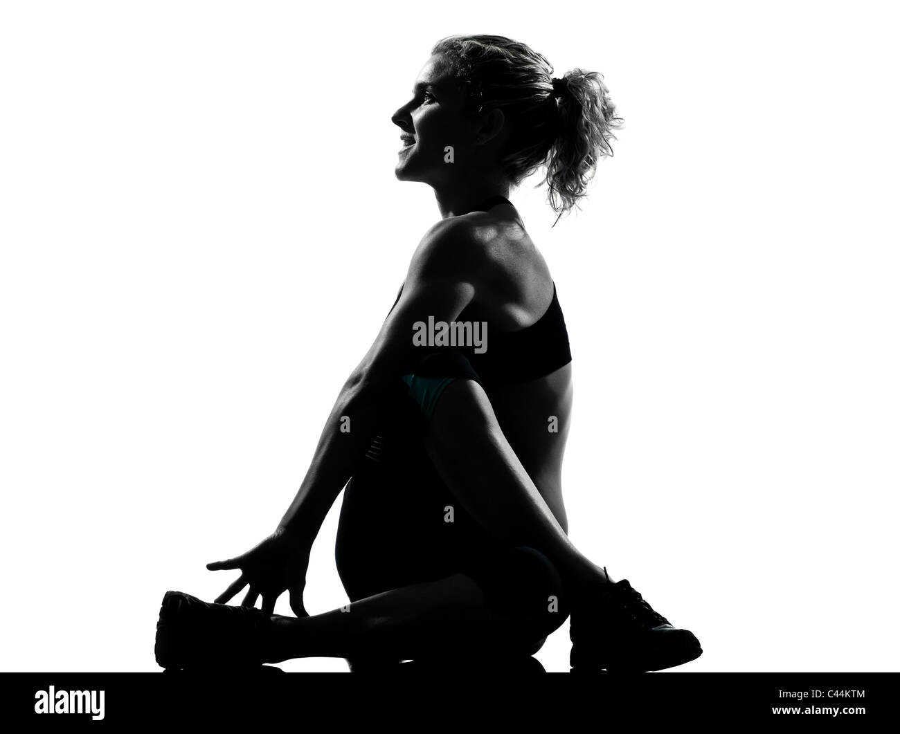 one woman exercising  warming up yoga stretching rotation fitness posture workout  aerobic posture on studio isolated - Stock Image