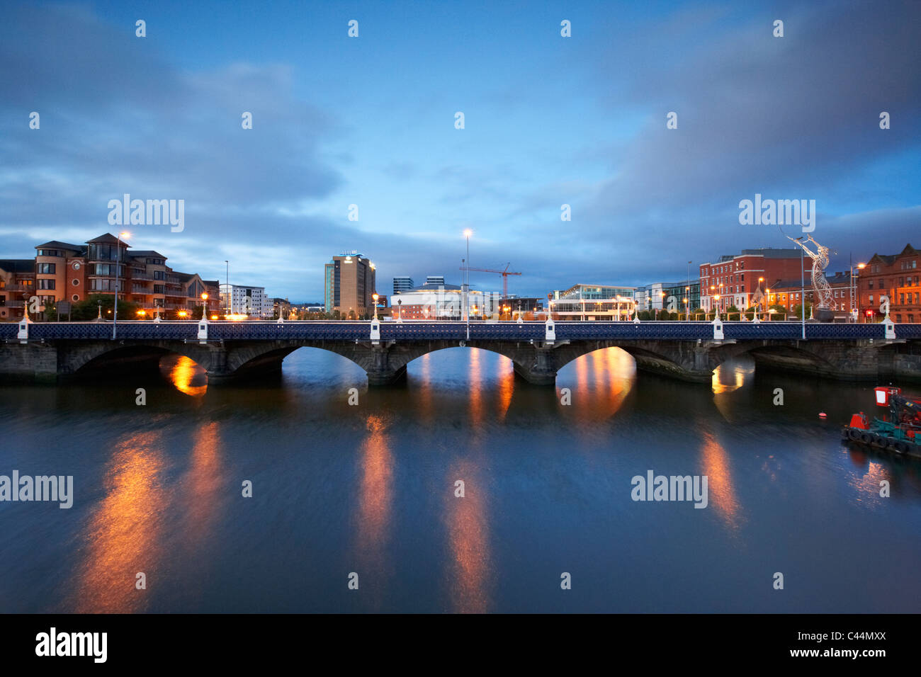 the queens bridge river lagan and laganside waterfront in the early morning blue hour in Belfast Northern Ireland - Stock Image