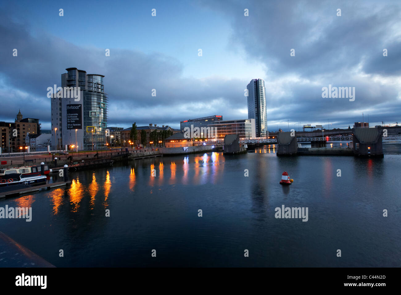 the boat obel tower river lagan weir and laganside waterfront in the early morning blue hour in Belfast Northern - Stock Image