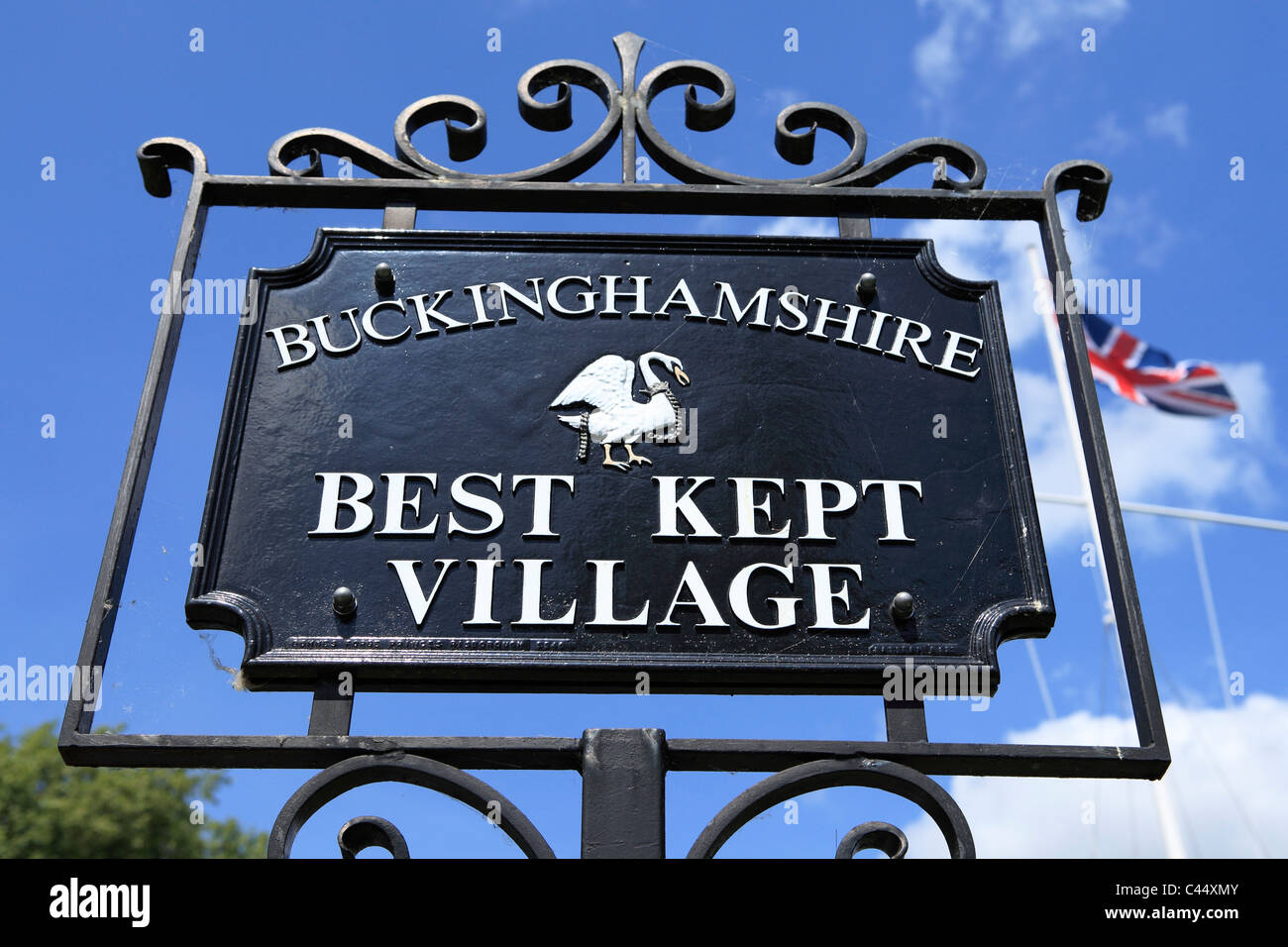 A sign on a village green in Marlow celebrates that this is Buckinghamshire's Best Kept Village. - Stock Image