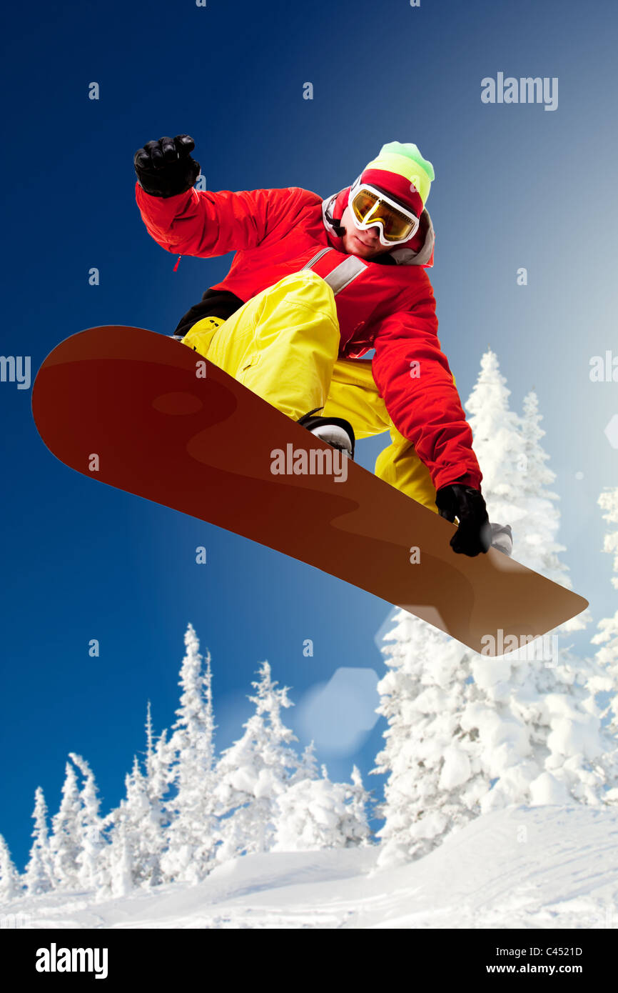 Portrait of snowboarder doing extreme trick - Stock Image