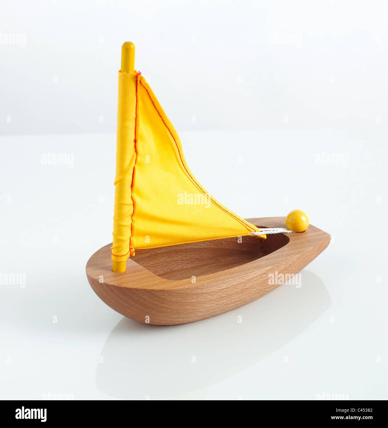 Toy boat with yellow sail, close-up - Stock Image