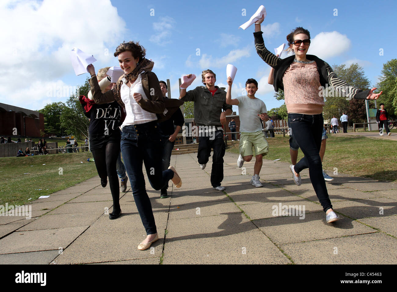 University students running to hand in their final dissertation papers on deadline day at Sussex University, Brighton, - Stock Image