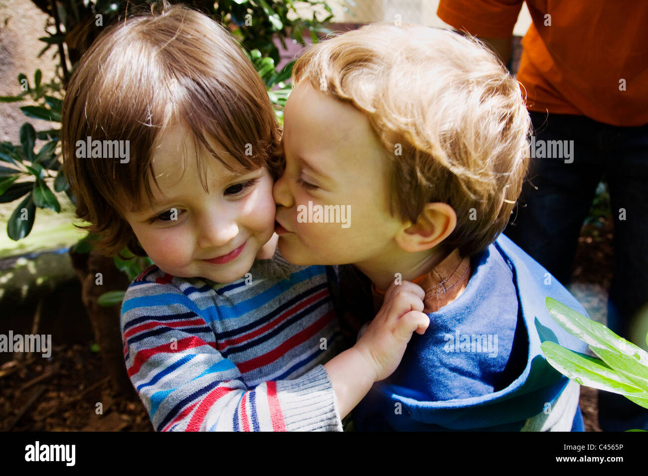 Young boy kissing his friend goodbye Stock Photo: 36993986 - Alamy
