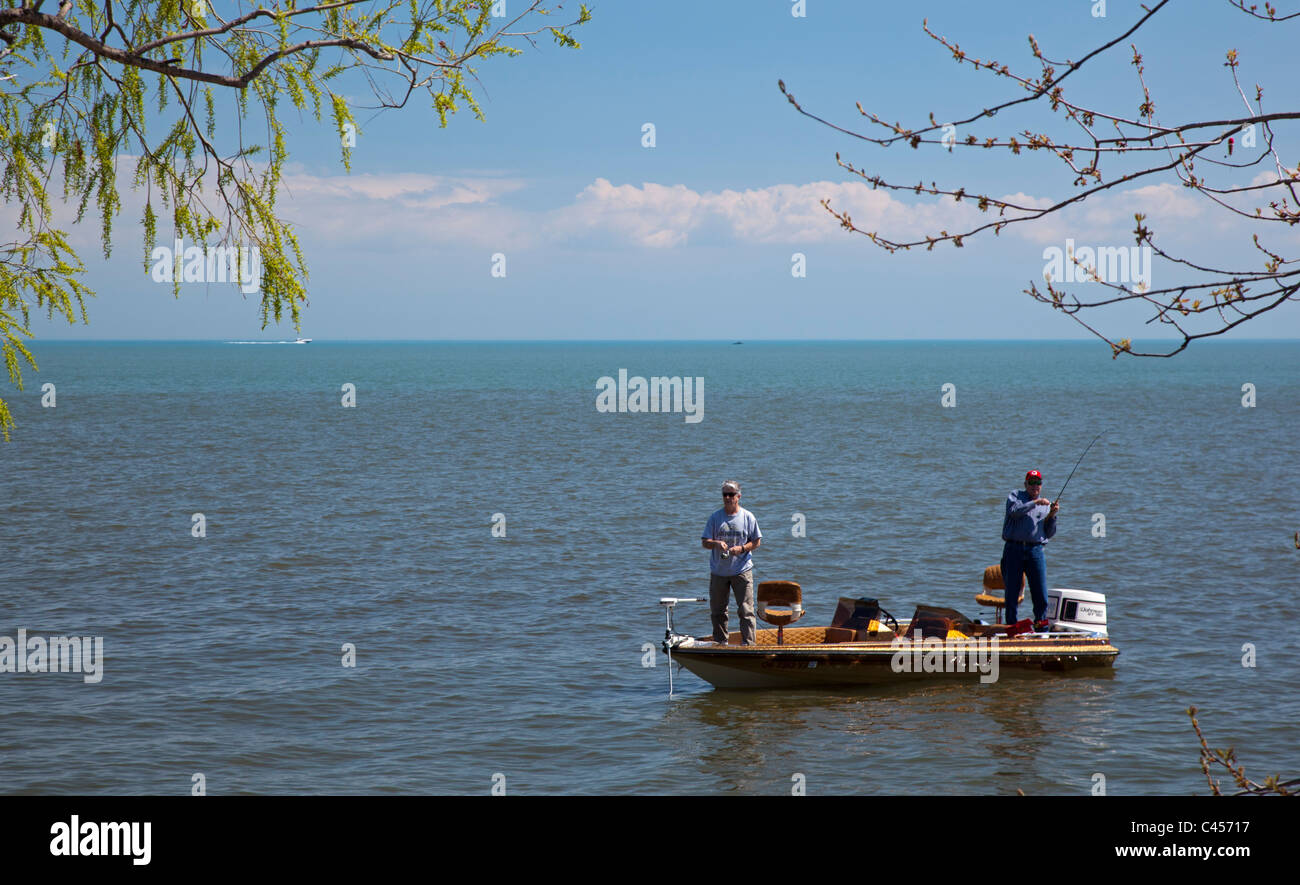 Harrison Township, Michigan - Two men fish from a boat on Lake St. Clair. - Stock Image