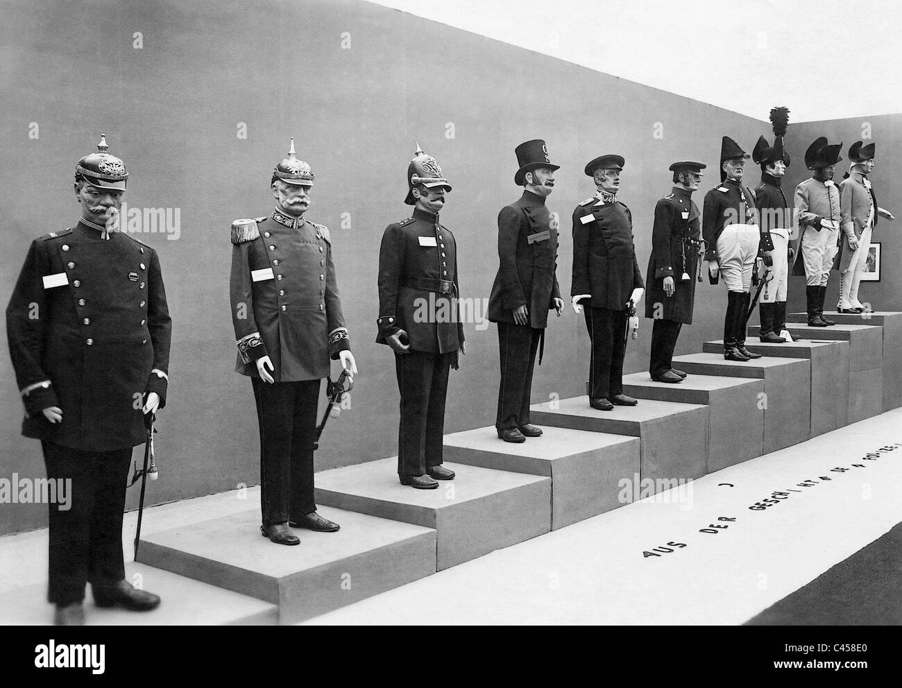 Historic police uniforms in an exhibition - Stock Image