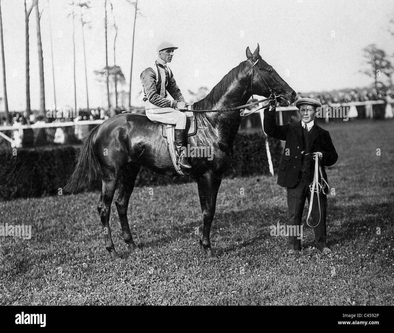 Jockey Childs with 'Fervor' at a horse race, 1910 - Stock Image