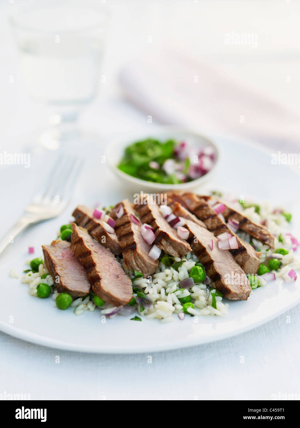 Sliced steak with rice on plate, close-up Stock Photo