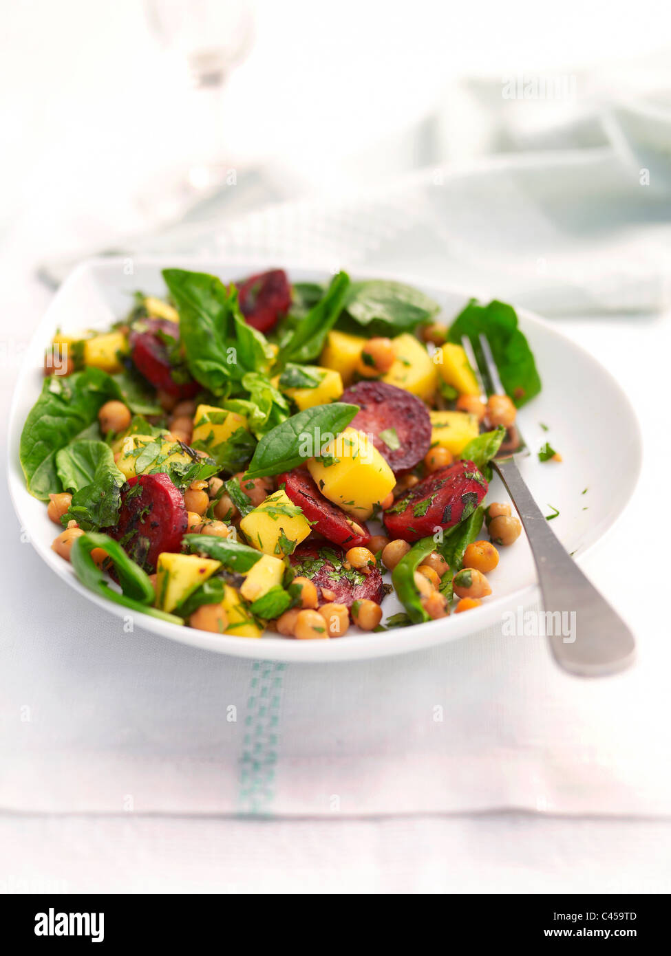 Bowl of chorizo mango salad, close-up - Stock Image