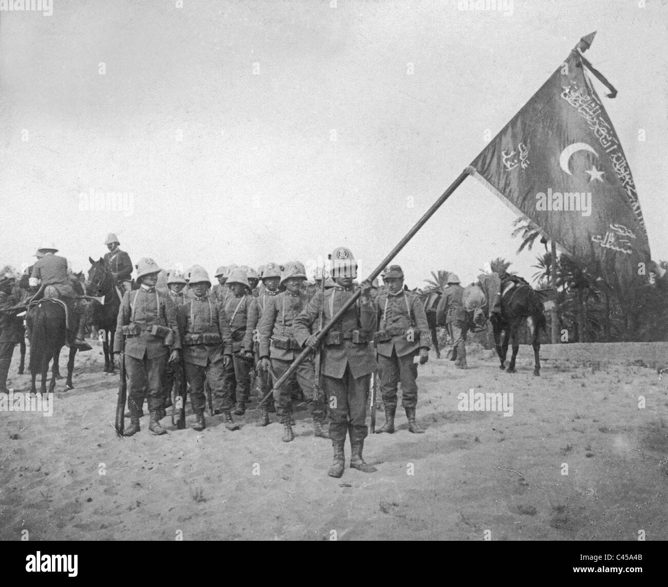 71acc1cfe92 Italian troops in Libya with a captured flag of the Ottoman troops