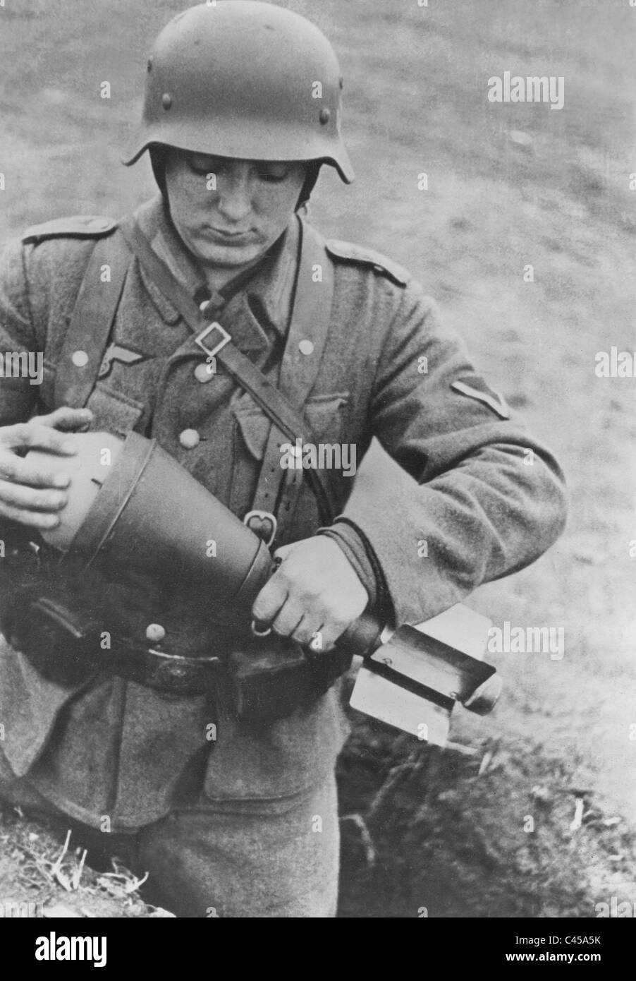 German soldier with a bazooka shell, 1944 - Stock Image