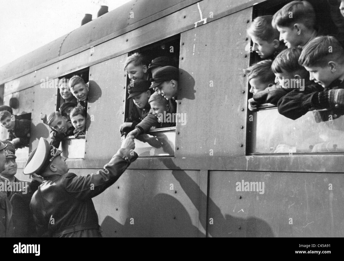 Hans Frank with children evacuated from German cities, 1943 - Stock Image