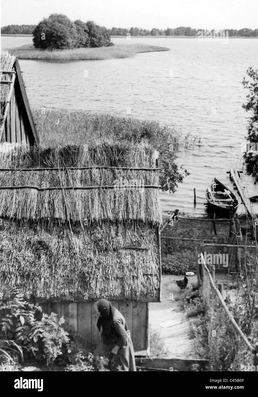 House with thatched roof on Lake Kruesten Stock Photo