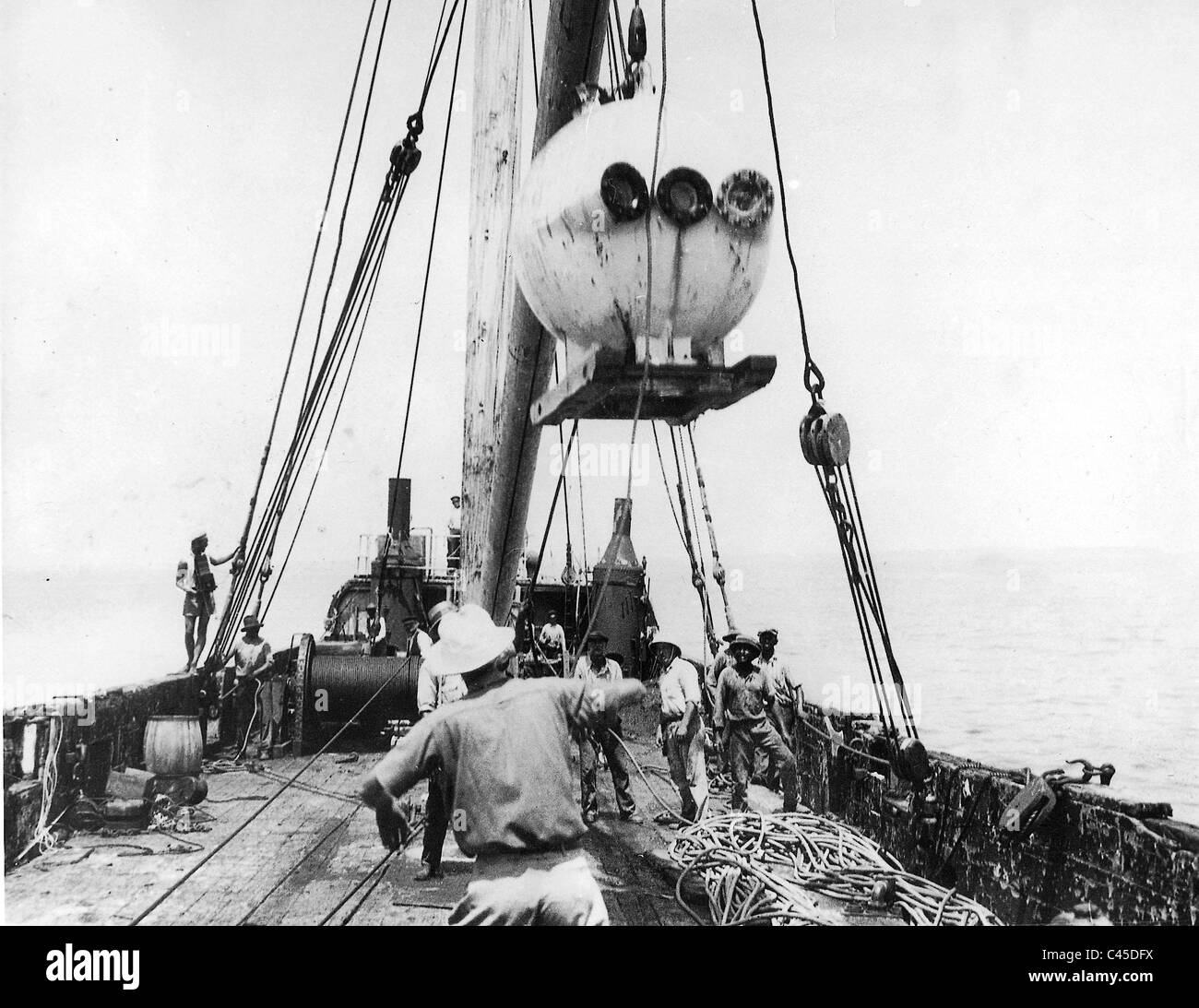 Diving Bell 'Bathysphere' on the expedition ship, 1932 - Stock Image