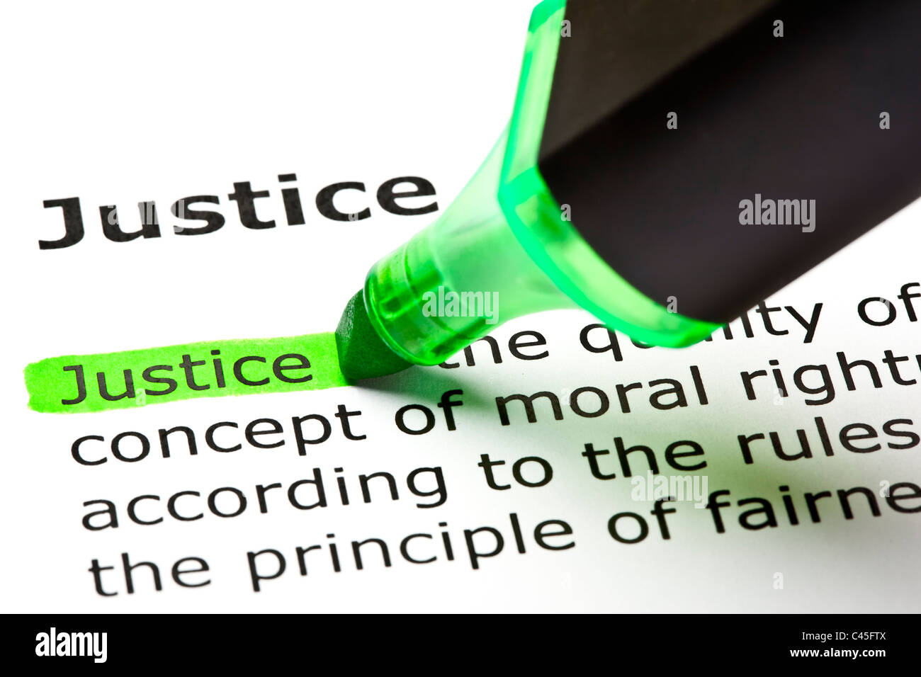 The word 'Justice' highlighted in green with felt tip pen - Stock Image