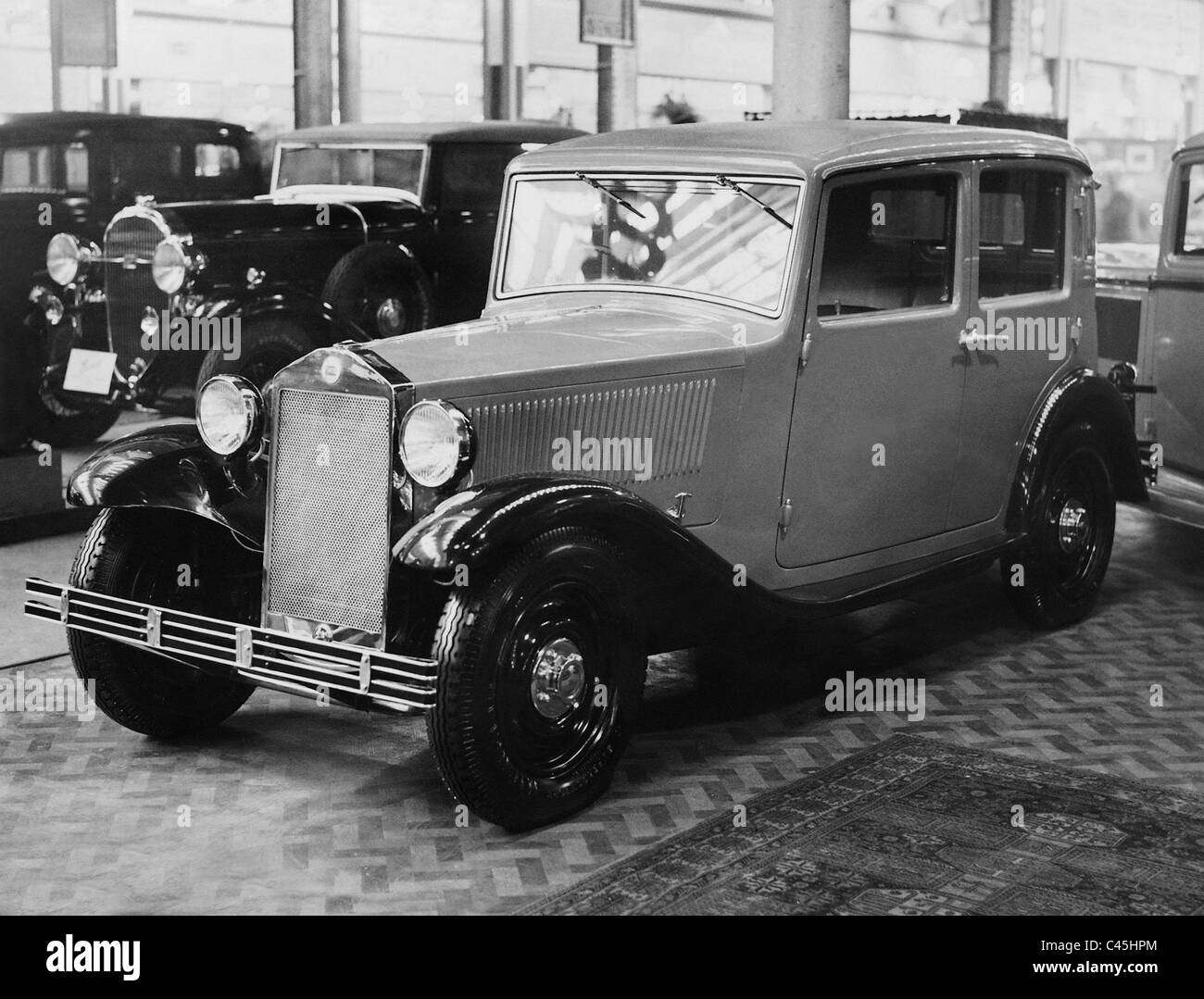 Model of a Lancia at the Motor Show in the Olympia Exhibition Halls in London, 1932 - Stock Image