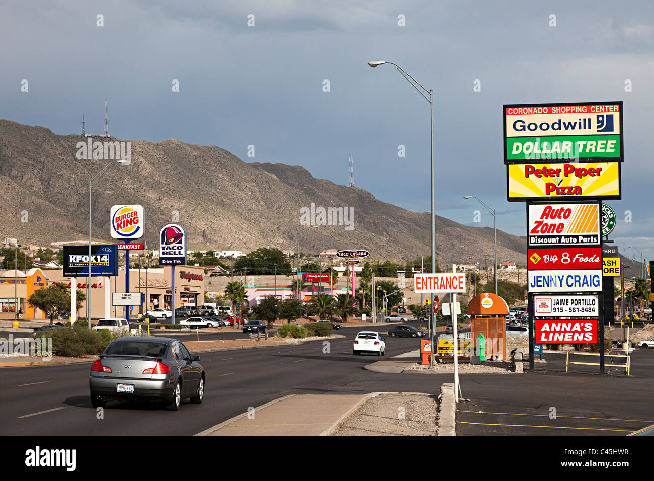 Road with fast food and mall signs El Paso Texas USA - Stock Image