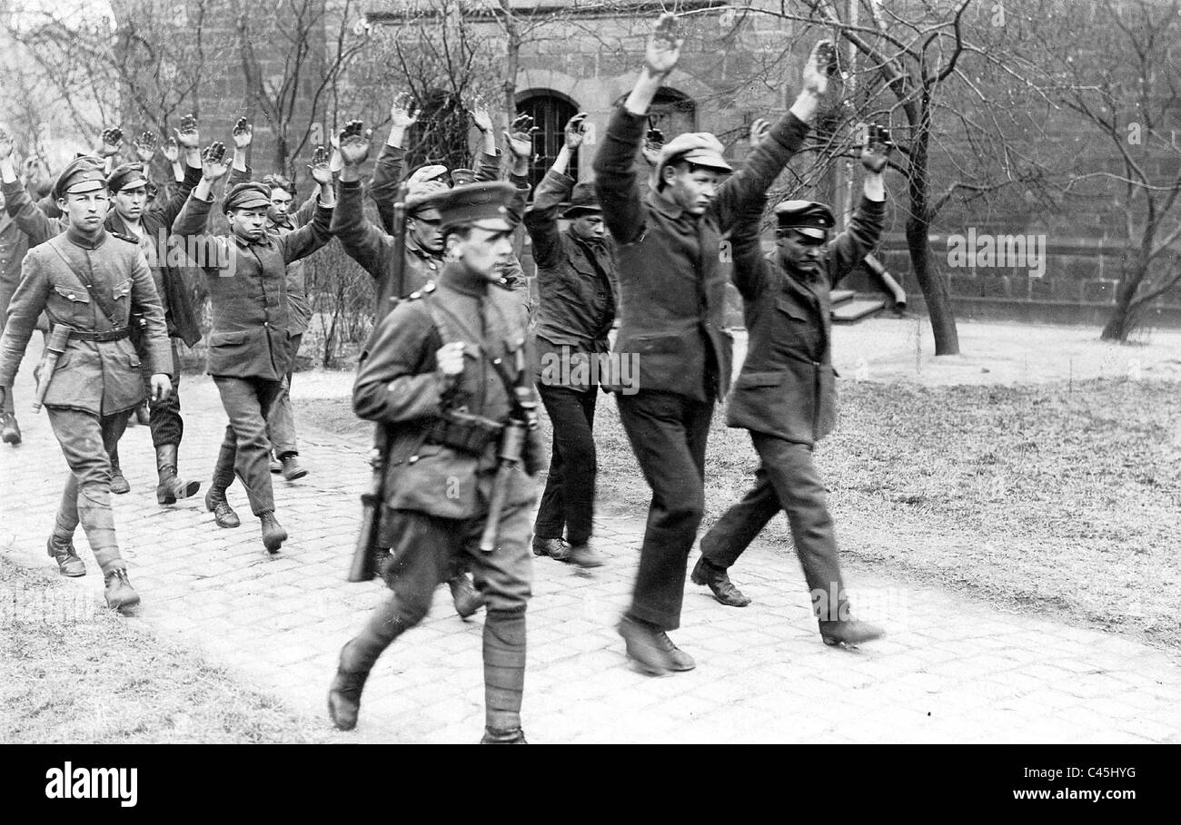 Arrested Communists are being lead away, 1921 - Stock Image
