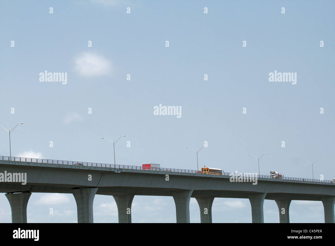 motor vehicles on high bridge - Stock Image