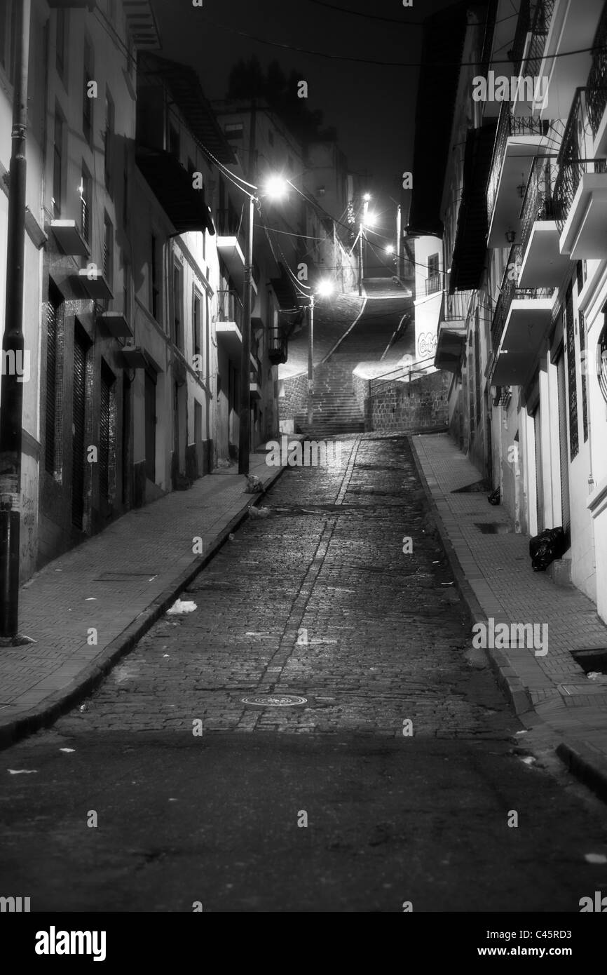 Black And White Night Images On The Outskirts Of Quito Neighborhood Well Known For High Crime Rate - Stock Image
