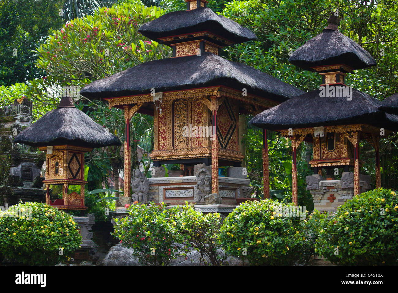 Three Hindu temples to Shiva, Brahma and Vishnu at PURA TAMAN SARASWATI - UBUD, BALI, INDONESIA - Stock Image