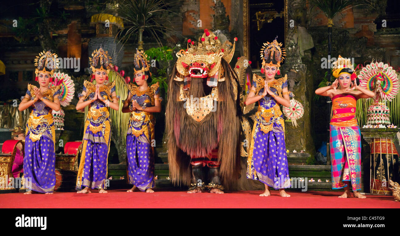 The BARONG DANCE is performed by the Cenik Wayah Gamelan Dance Group at PURA TAMAN SARASWATI - UBUD, BALI, INDONESIA - Stock Image