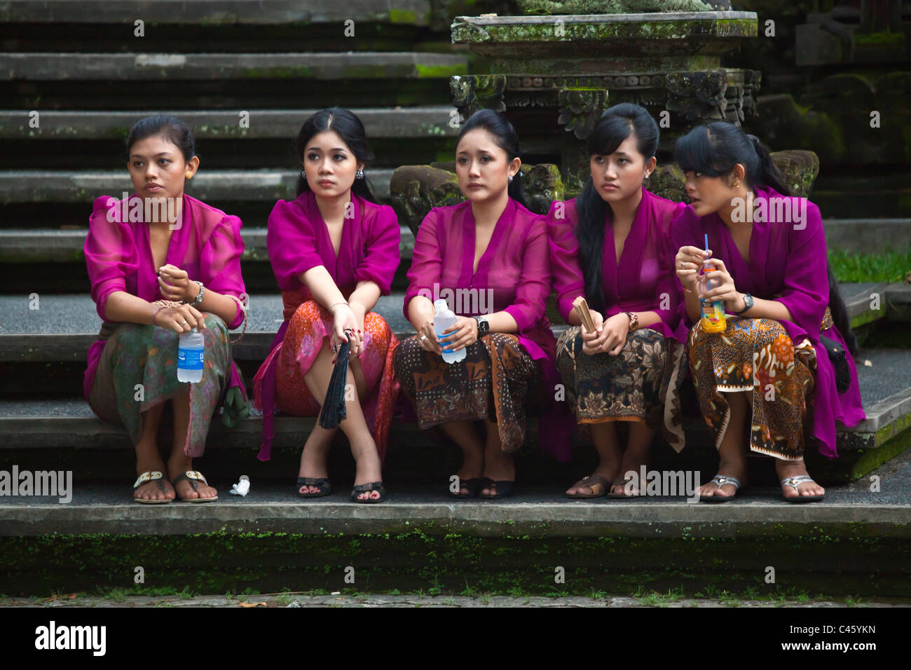 Relatives participate in a Hindu style CREMATION - UBUD, BALI, INDONESIA - Stock Image