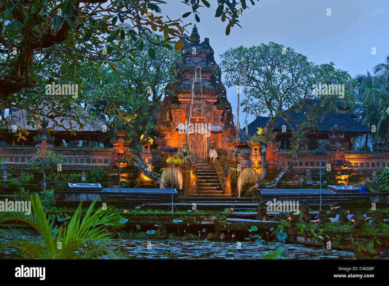 PURA TAMAN SARASWATI known as the UBUD WATER PALACE at dusk - UBUD, BALI, INDONESIA - Stock Image