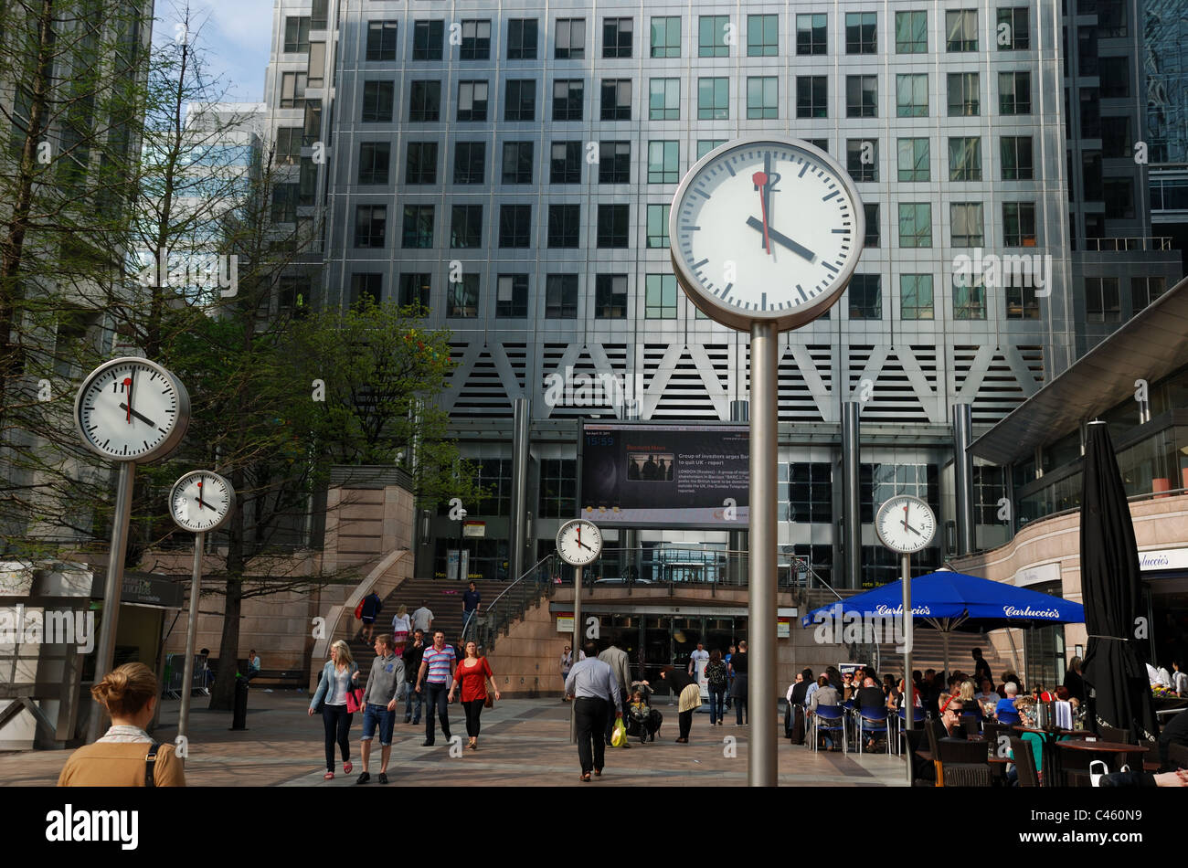 Clocks in front of One Canada Square, Canary Wharf, London, UK. Europe. - Stock Image