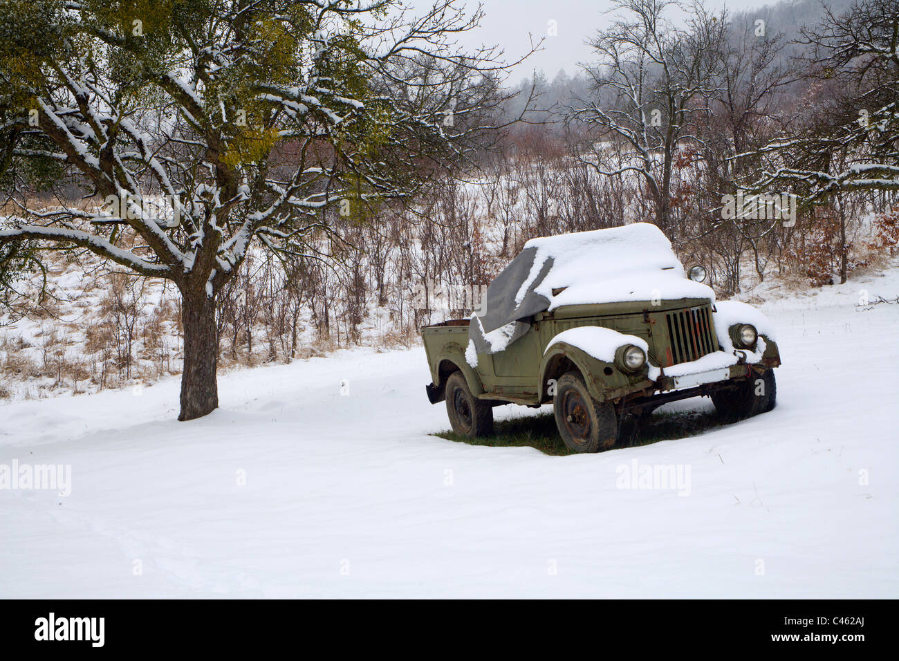 old car in winter - Slovakia country - Stock Image