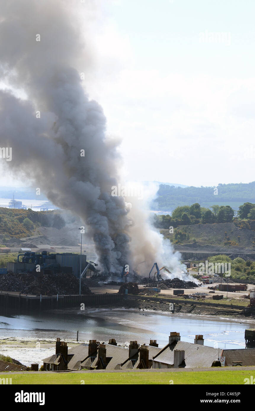 Large fire at scrap metal yard  which started early this morning at Robertson Metals Recycling,Inverkeithing Fife. - Stock Image