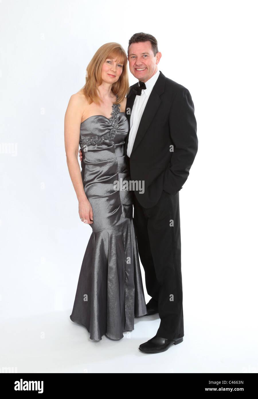 Couple wearing smart formal wear. - Stock Image