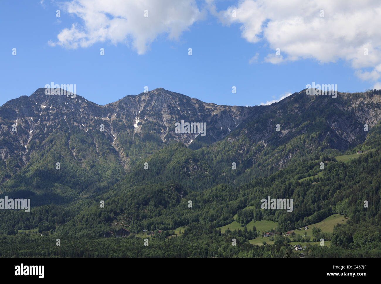 The Kalmberg mountain in Austria towering over the outskirts of Bad Goisern. - Stock Image