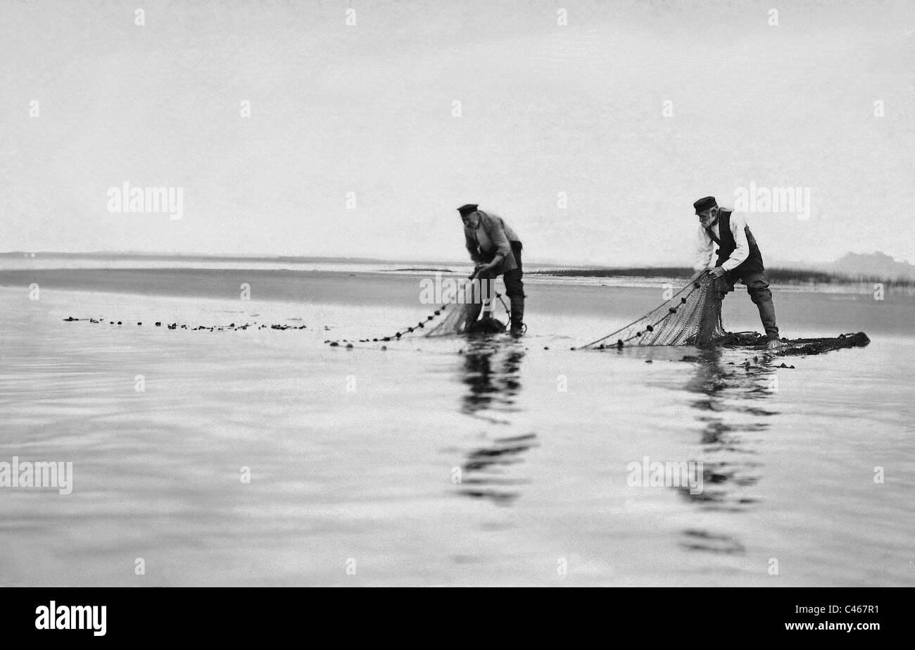Fishermen take in their nets, 1911 - Stock Image