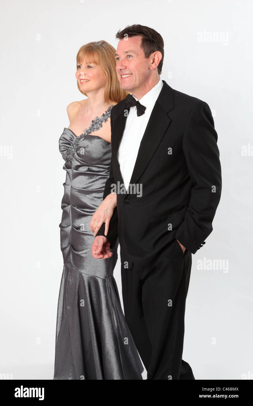 Couple wearing smart evening dress and suit with bow tie. Stock Photo