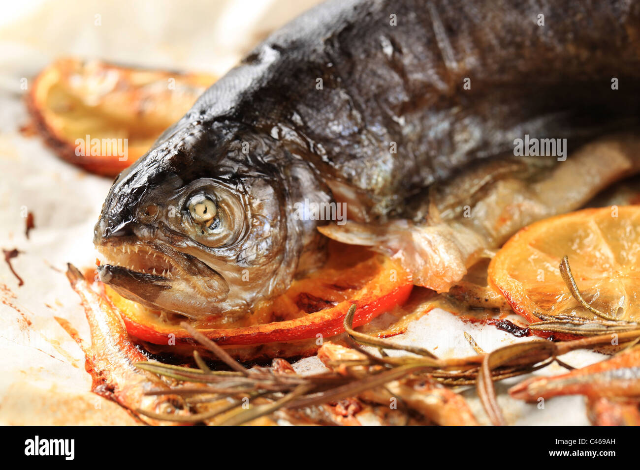 Pan fried trout, anchovies and lemon - detail - Stock Image