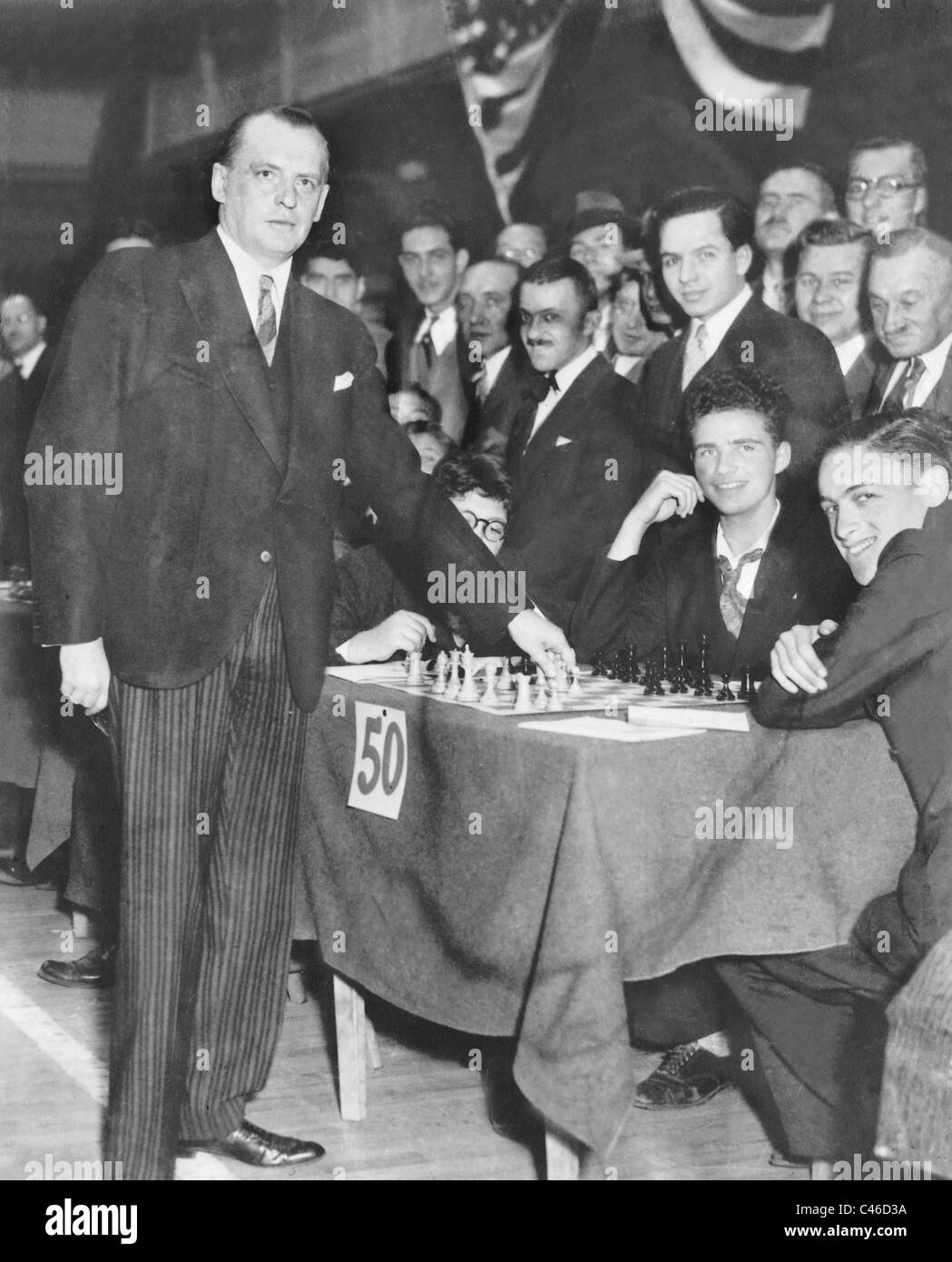 Alexander Alekhine playing simultaneous chess matches - Stock Image