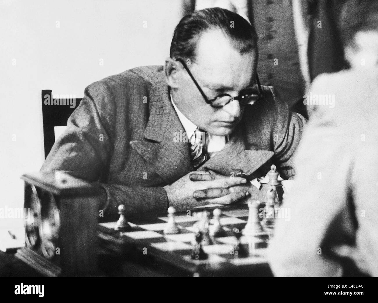 Alexander Alekhine playing chess, 1936 - Stock Image