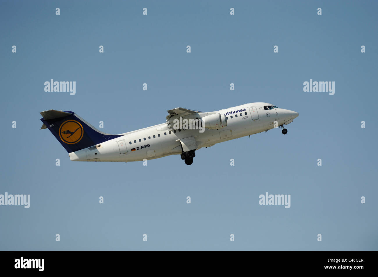 airplane Avro RJ85 of german airline Lufthansa at take-off from airport Munich in Germany - Stock Image