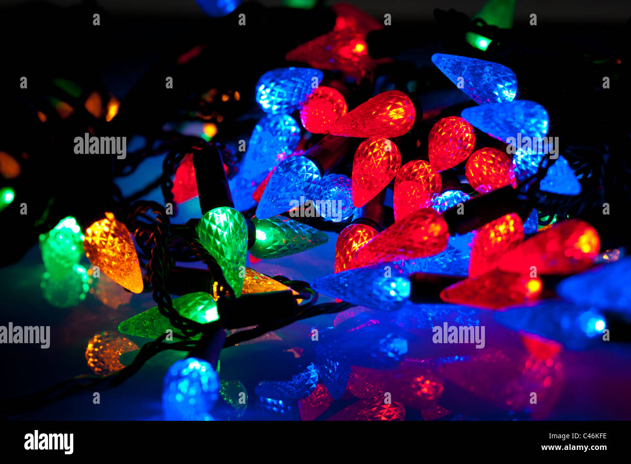 Cone shaped multicoloured Christmas lights - Stock Image